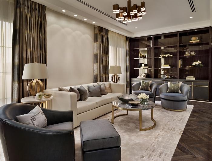 wohnung einrichten, wohnzimmer interieur in neutralfarben, deisgner möbel mit goldenen elementen