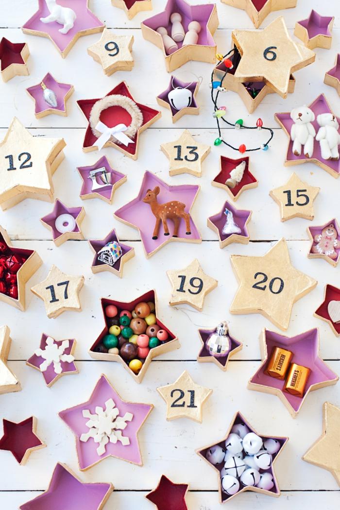 Adventskalender selber machen, Schachtel in der Form von Sternen mit kleinen Geschenken darin