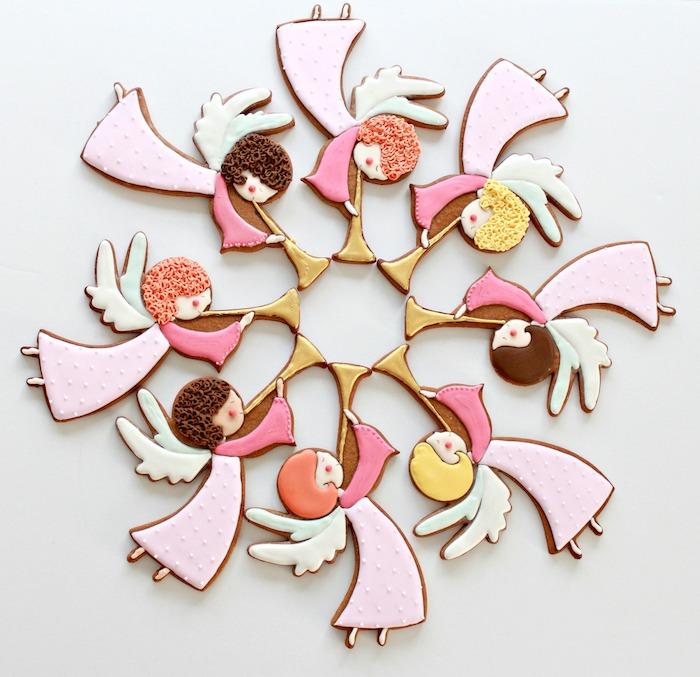 Schöne und leckere Weihnachtsplätzchen in Form von süßen Engeln zum Ausstechen
