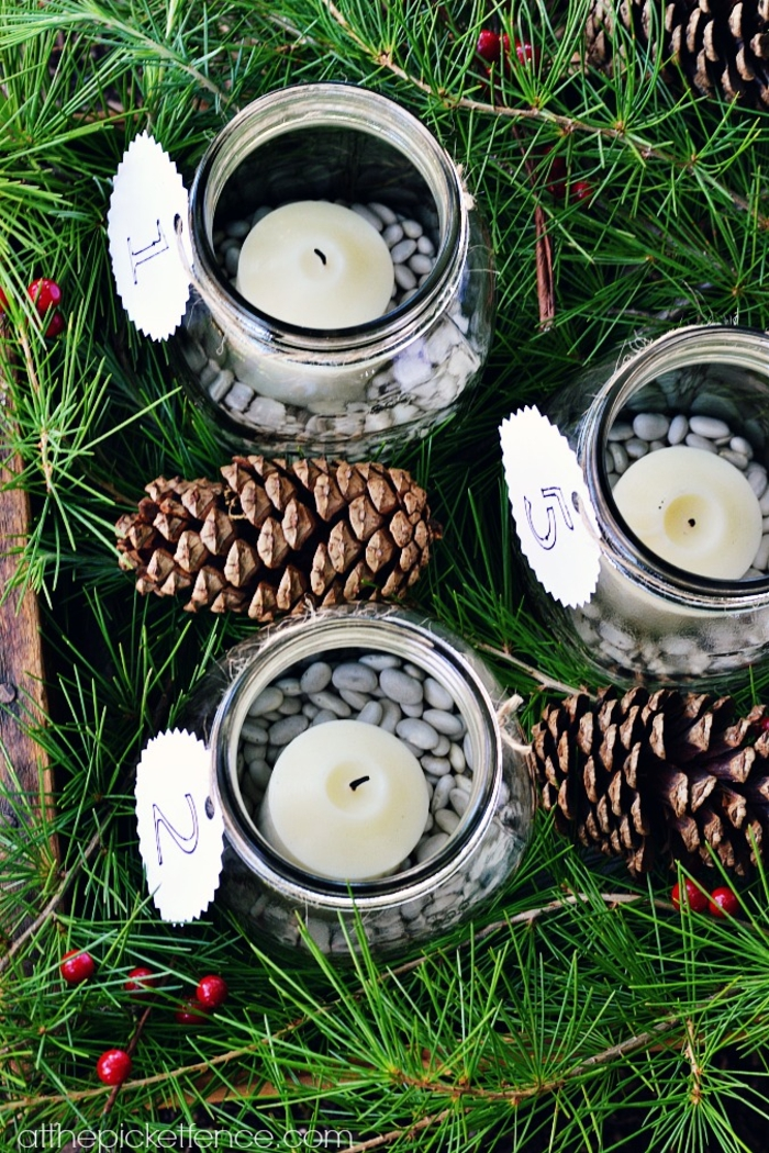 drei von den Weckgläsern, voller Bohnen und Teelichter in weißer Farbe, Adventskalender basteln