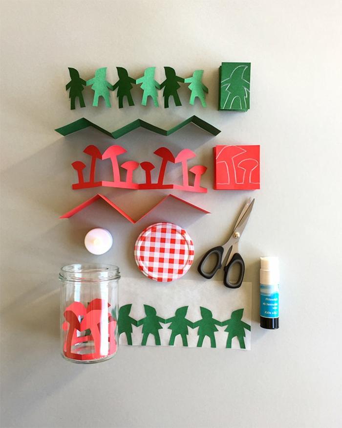 Laterne Bastelset, kleine Figuren aus grünem und rotem Papier, eine Schere, ein Deckel