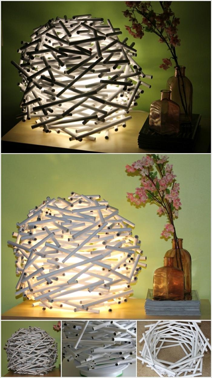 eine Laterne, die hell leuchtet aus kleinen Stöcken hergestellt, Bastelanleitung Laterne