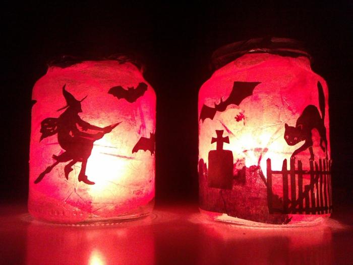 zwei Halloween Laterne, mit Hexe auf Besen und schwarze Katze und Fledermaus