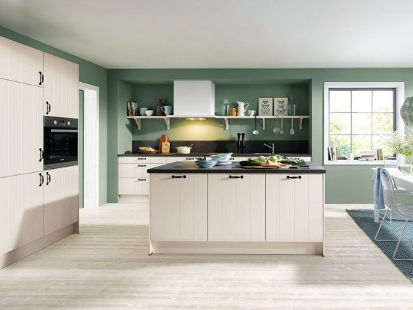 eine grüne Küche in moderner Wohnung