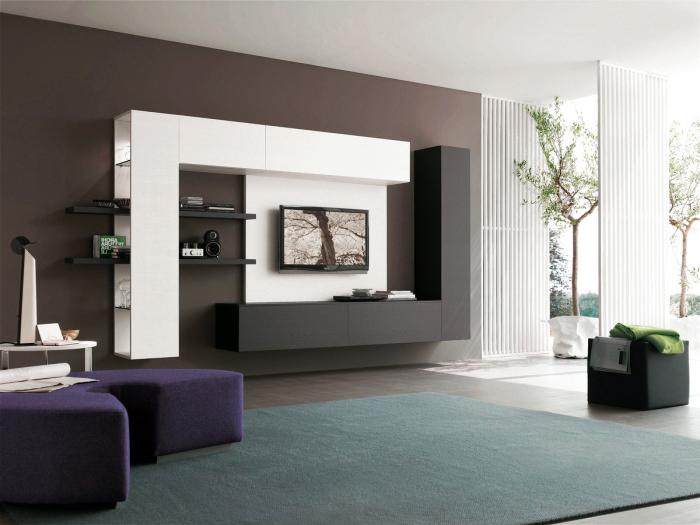 moderne wohnände, schrankwand in weiß und grau, großer teppich, lila hocker, designer möbel