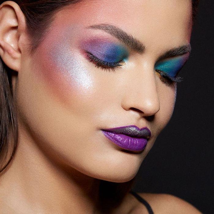 junge frau mit violetten lippen und einer einhorn schmkine mit blauen und grünen lidschatten und schwarzen wimpern, einhorn bilder
