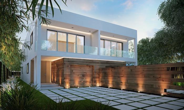 weißes haus mit terrasse und ein vorgarten, boden aus weißen fliesen und ein zaun aus holz, bäume mit grünen blättern in einem vorgarten