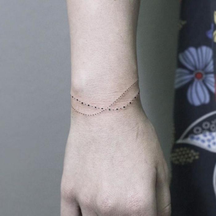 tattoovorlagen für die beiden geschlechter, zwei armbänder aus punkten gemacht
