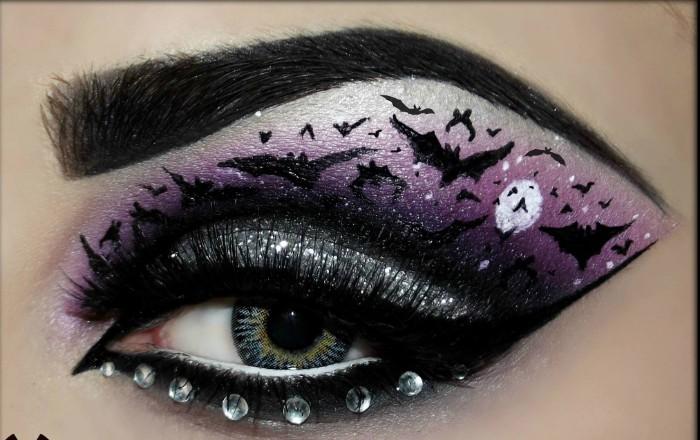 halloween gesicht schminken, akzent auf die augen, kleine tierchen bath zeichnen am augenlid, steine ankleben, lila lidschatten