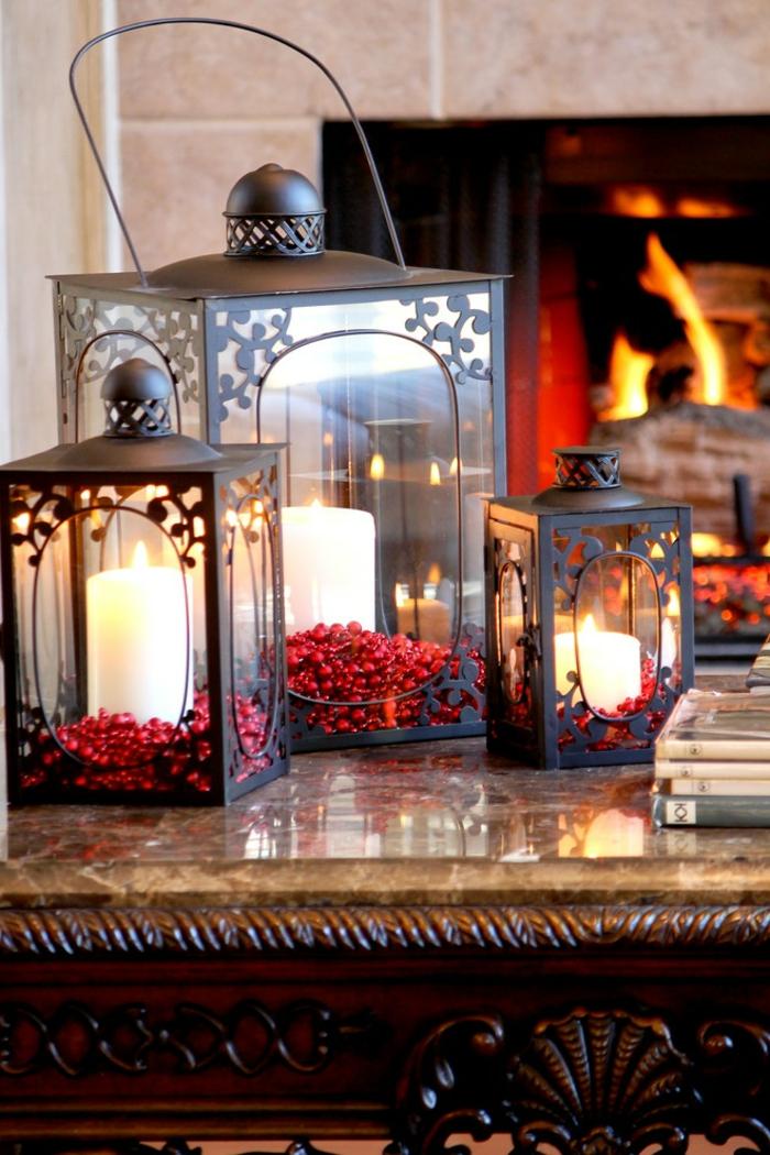 drei Laterne mit verschiedenen Größen mit weißen Kerzen, Laterne selber basteln