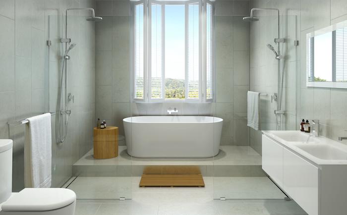 graues badezimmer mit einem großen fenster und eine weiße freistehende badewanne und weißem waschbecken