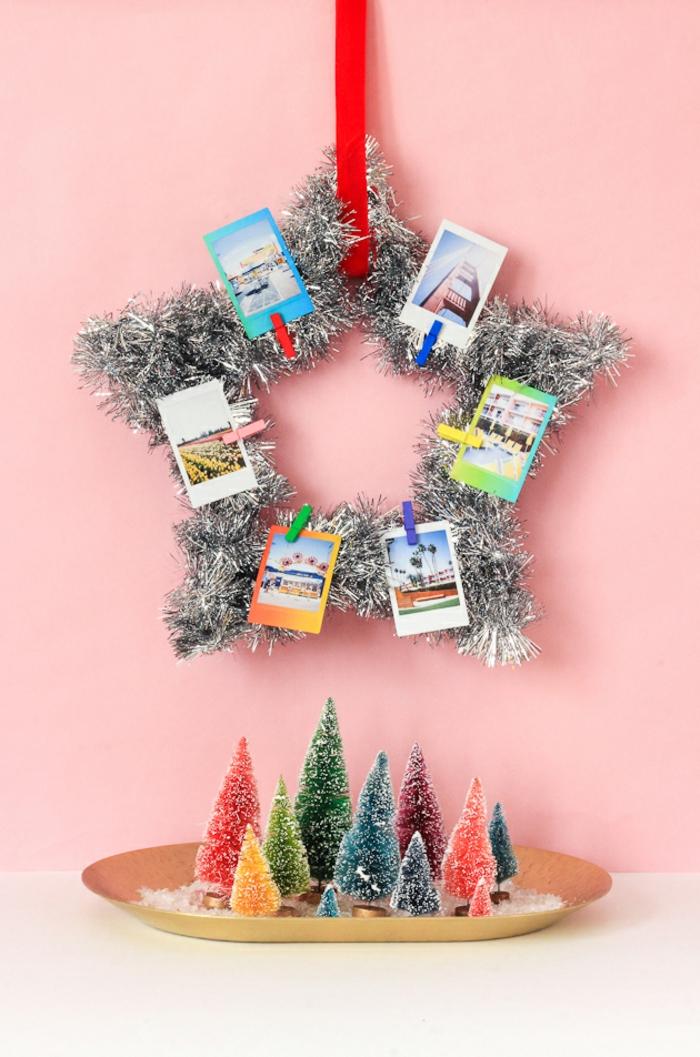 Weihnachtssterne basteln, ein großer silberner Weihnachtsstern mit Fotos geschmückt