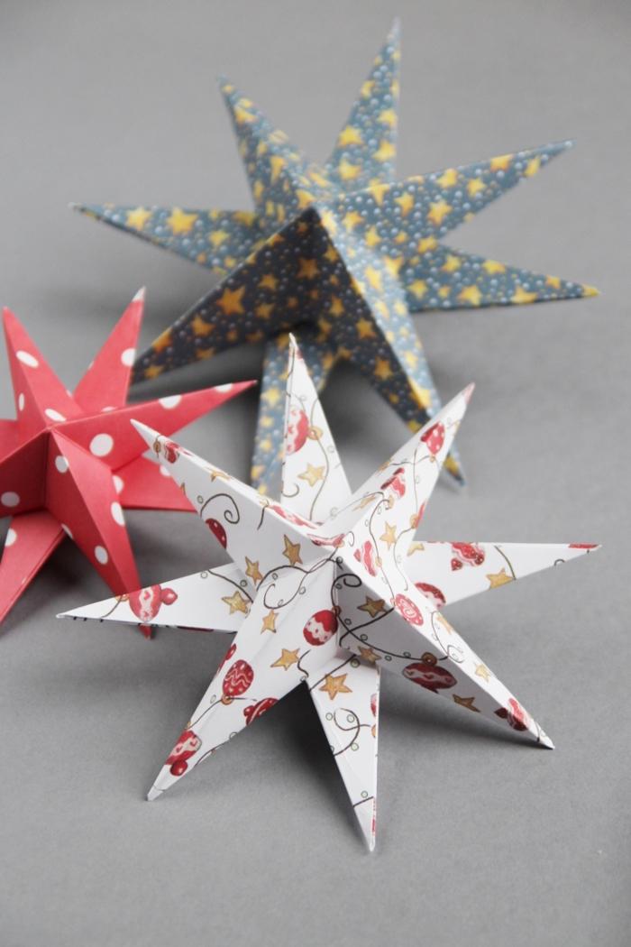 ein weißer Stern mit Motiven von Christbaumdeko, Weihnachtssterne basteln, roter Stern mit Tupfen