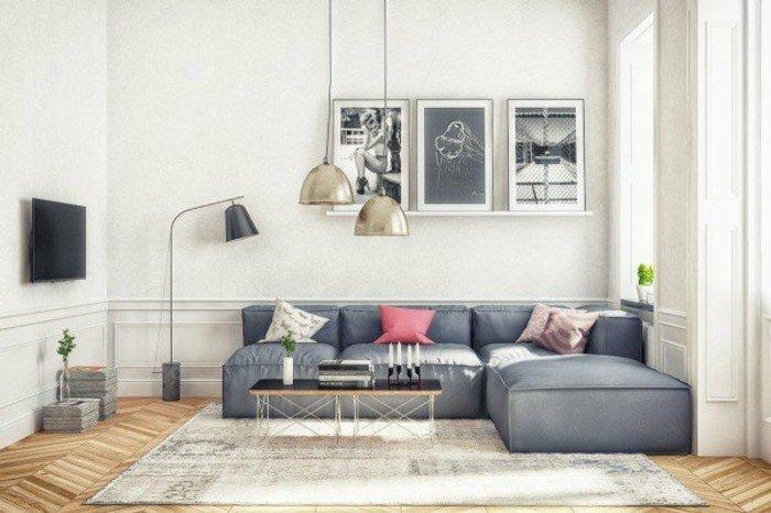 Wohnzimmer in Weiß Grau, ein brauner Teppich, rosa Kissen, eine schwarze Lampe, Parkettboden