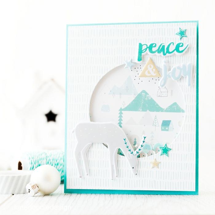 weiße Karte mit blauem Aufschrift Frieden und Freude, ein Renntier, lustige Weihnachtskarten