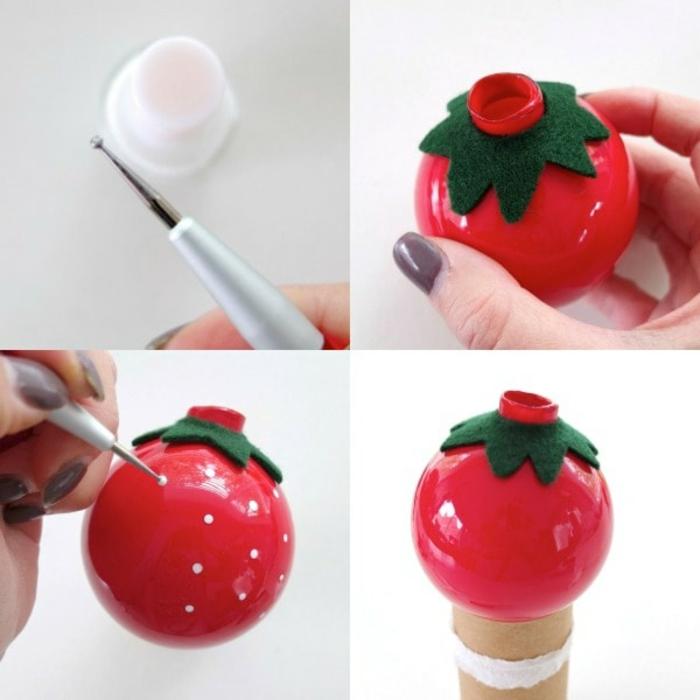 rote Kugeln wie Erdbeeren mit kleinen weißen Punkten, grünes Papier, Weihnachtskugeln selber basteln