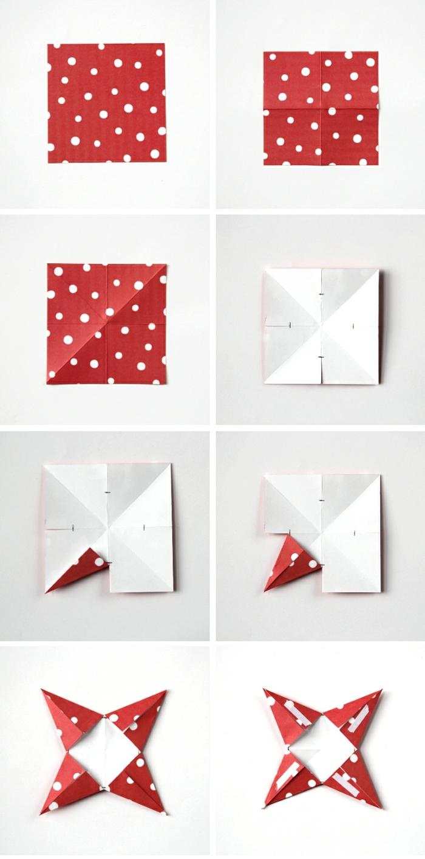 ein Stück rotes Papier mit Tupfen, eine Faltanleitung, Weihnachtssterne basteln