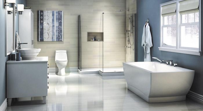 weiße freistehende badewanne im b´badezimmer mit weißem waschbecken und blauen wänden, moderne badezimmer einrichten