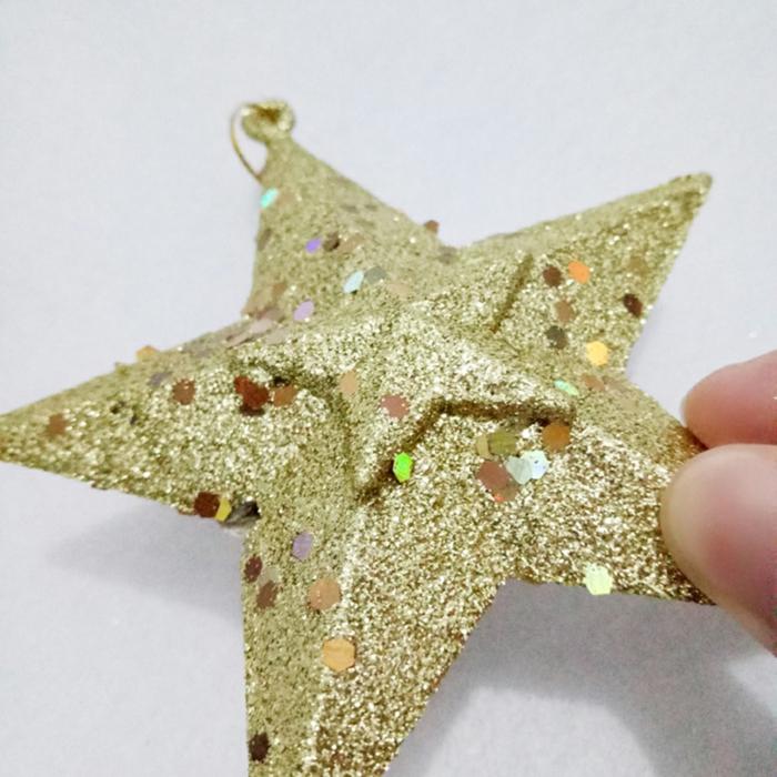 goldener Stern mit fünf Spitzen, kleine bunte Streusel, Basteln zu Weihnachten