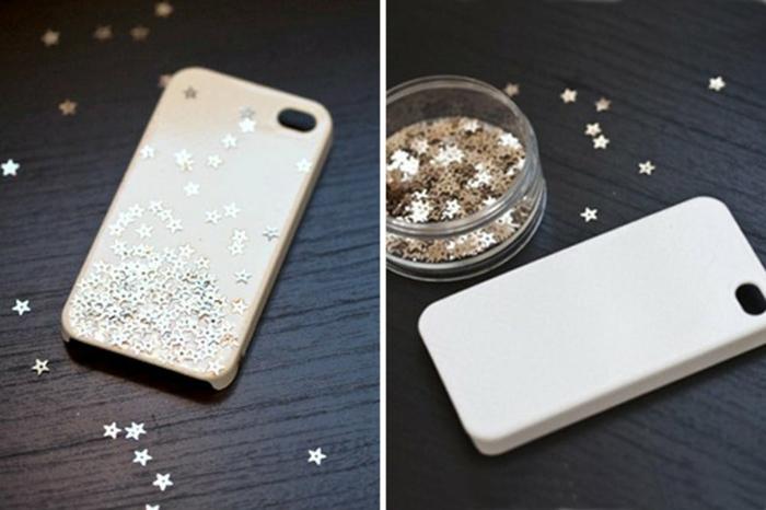 weiße Handyhülle, kleine glänzende Sternchen, mit denen Sie die Handyhülle bekleben, personalisierte Handyhülle