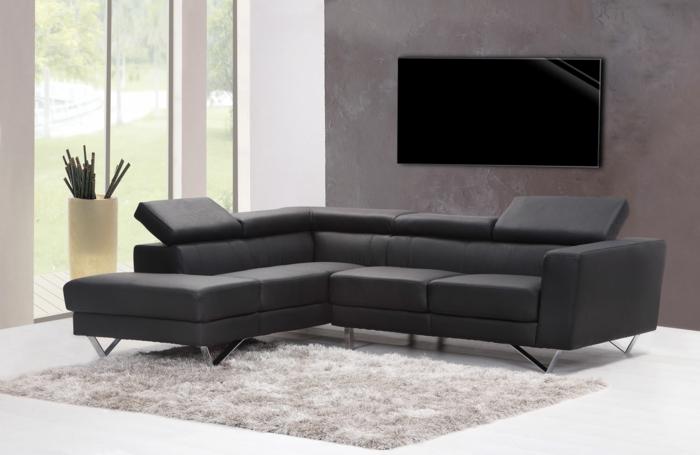 Heizen mit Stil, schwarze Heizung im Wohnzimmer