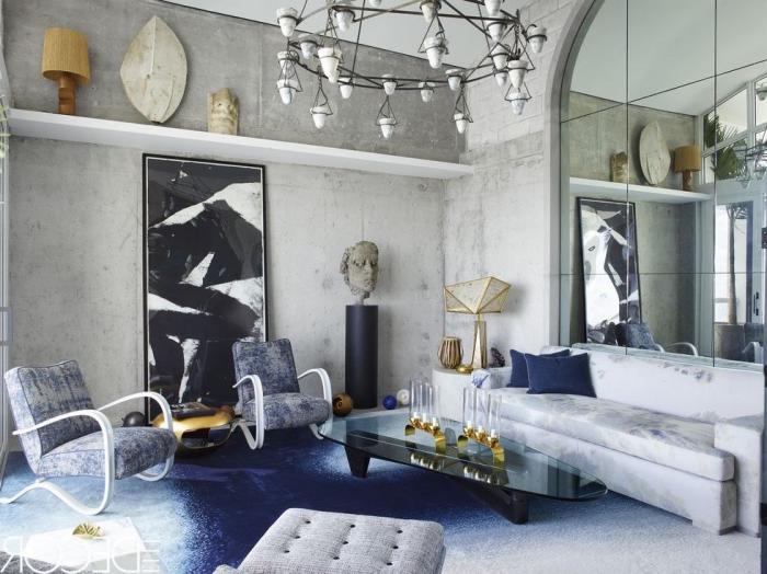 waddeko wohnzimmer, abstraktes bild in schwarz und weiß, teppich in ombre effekt, statue kopf