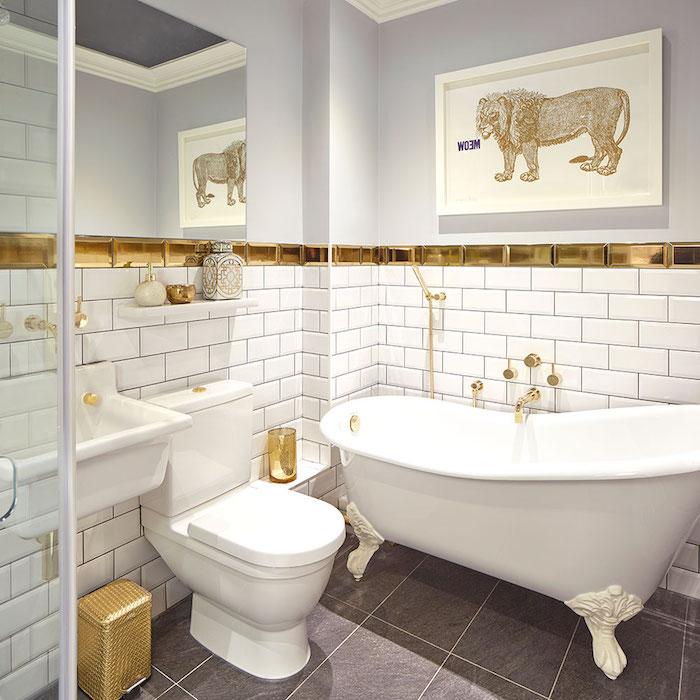 spiegel und ein weißes waschbecken, grauer boden aus badezimmer fliesen und eine weiße badewanne