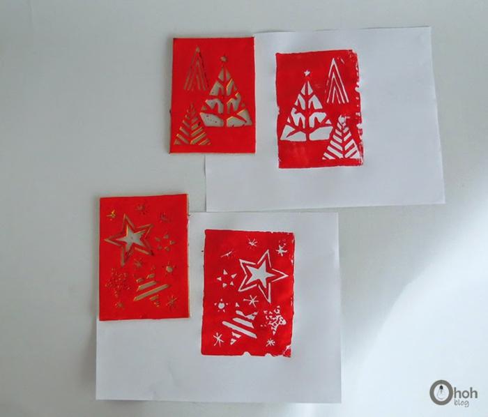 stempeln Sie auf weißem Papier mit roter Farbe, Tannenbäume und Sterne, Weihnachtskarten selber machen