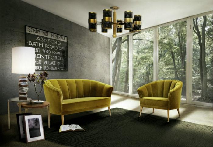 Wanddeko Wohnzimmer, graue Wände, zwei grüne Wohnzimmermöbel, Eine Glaswand, zwei Tische