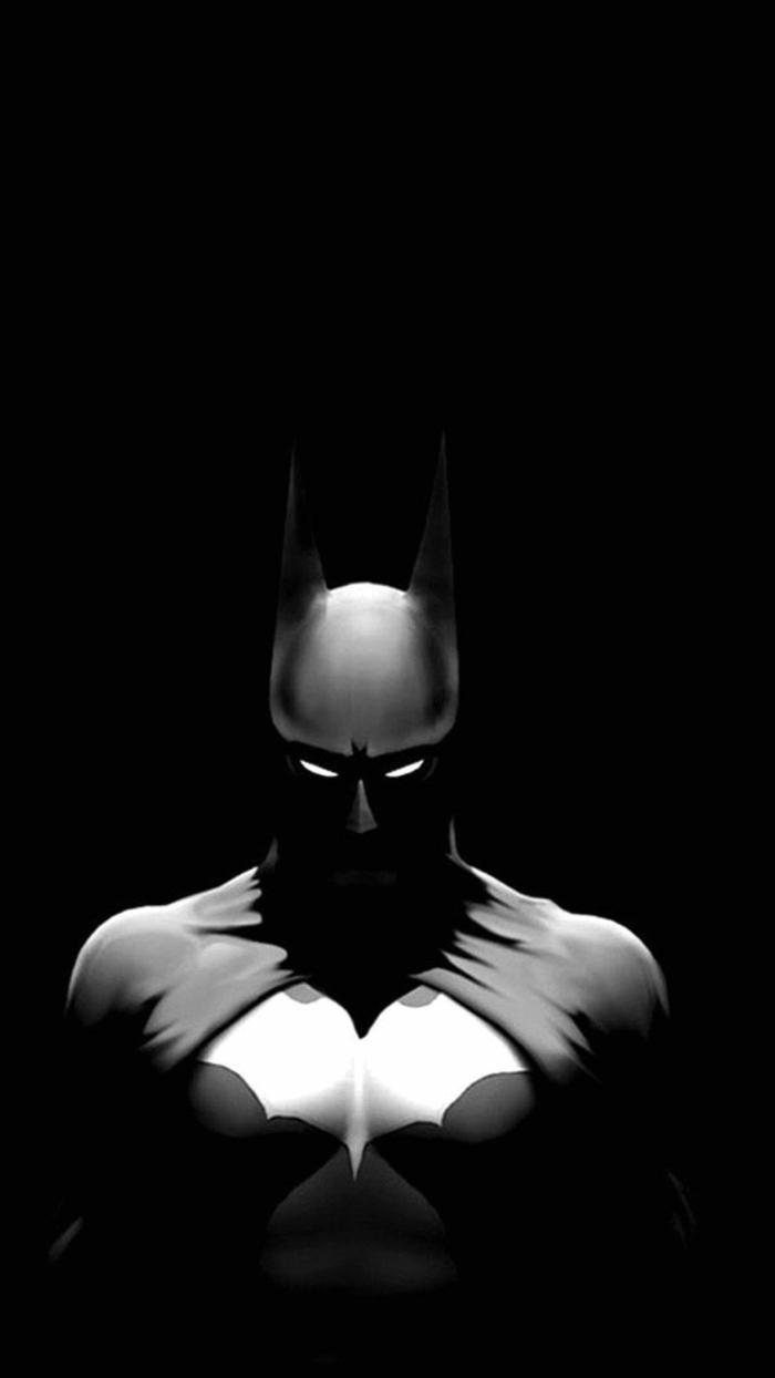 ein Batmann mit schwarzem Kostüm, schwarzer Hintergrund, leuchtende Augen, schöne Handy Hintergrundbilder