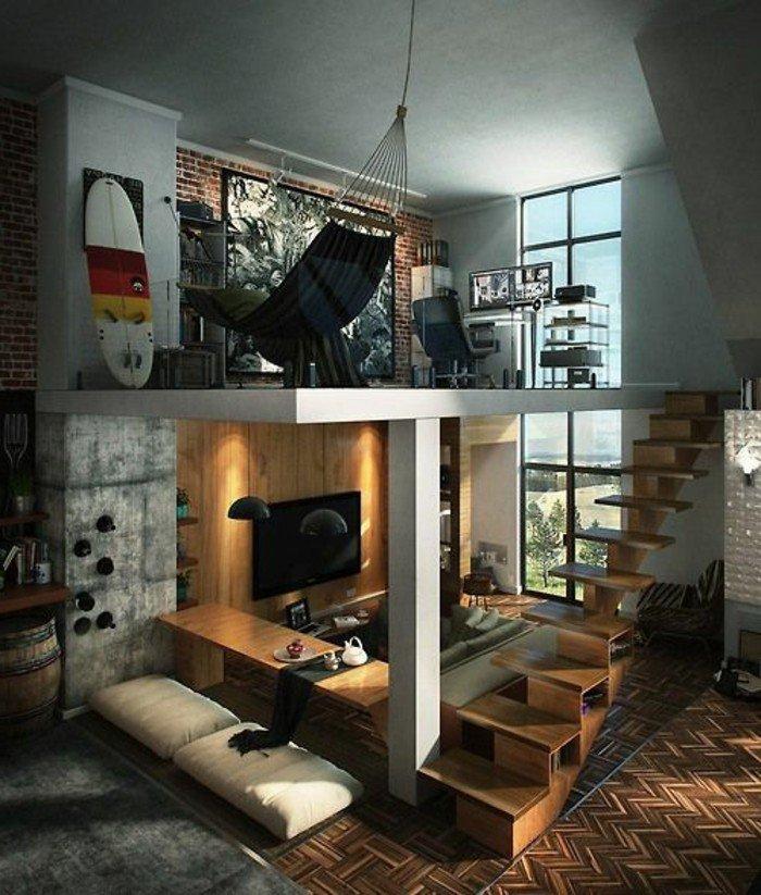 Wohnzimmer gestalten, eine Treppe, ein Hängematte, graues Sofa und eine Fernsehwand
