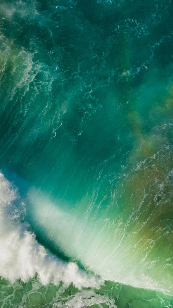 ein Wasserfall mit einem Regenbogen, viel Schaum, Hinergrundbilder kostenlos mit viel Wasser