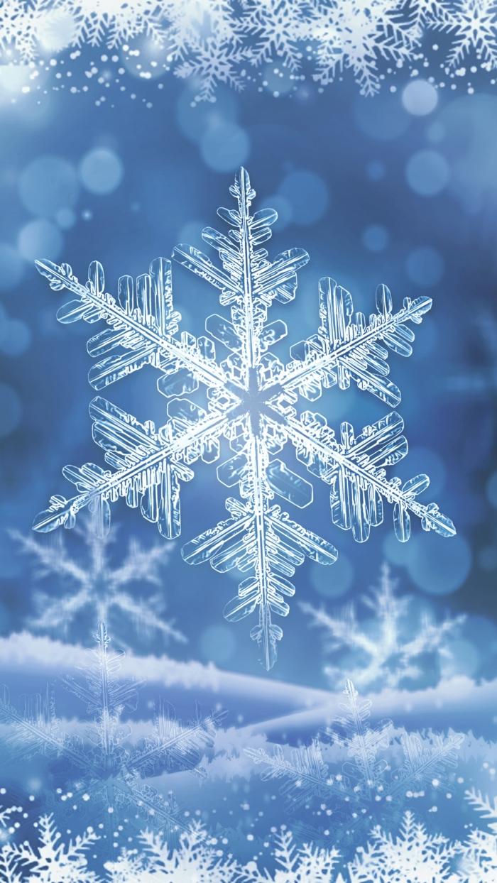 blauer Hintergrund mit kleinen Schneeflocken, eine große Schneeflocke in der Mitte, coole Hintergrundbilder