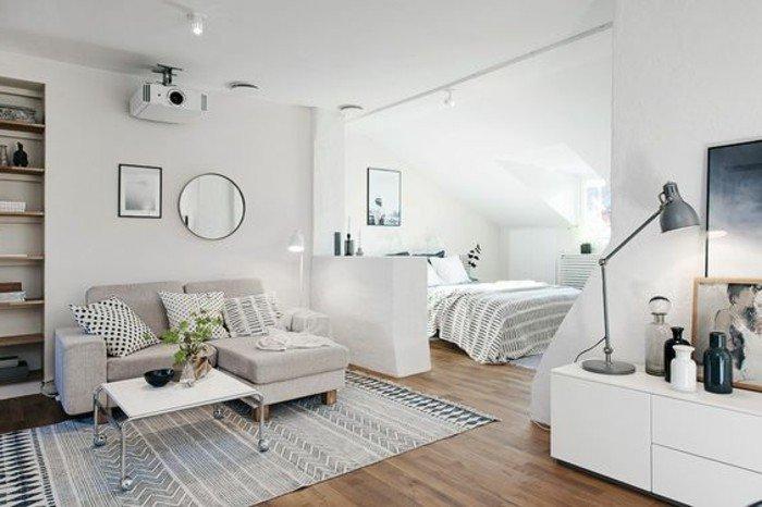 skandinavisches design zimmer einrichten, weiß grau ideen elegant, große einzimmerwohnung, sofa mit liegebereich raumteiler doppelbett