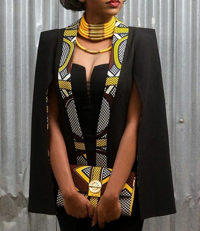 party outfit damen die in dem stil einer anderen kultur tauchen wollen, schöne ideen, schwarzes damenoutfit mit gelb weiß und braun deko muster und tasche mit den selben motiven