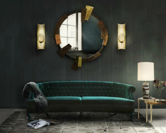 ein runder Spiegel mit ausgefallenen Rahmen, ein grünes Sofa, ein grauer Teppich, Wandgestaltung Ideen selber machen
