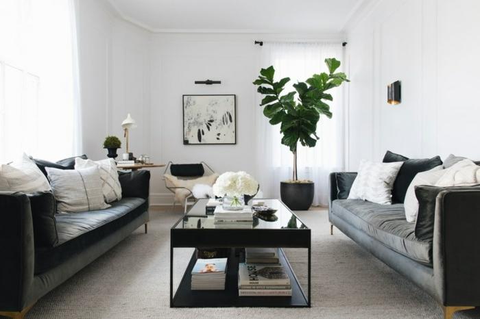 Deko Ideen selbst machen, zwei schwarze Sofas, eine Wohnung nach Feng Shui geordnet