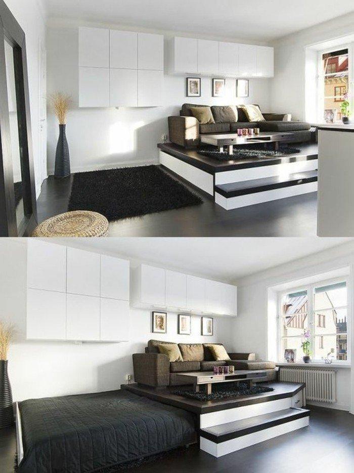 weiße Regale, ein grauer Teppich, braunes Sofa, kleine Bilder, ein kompaktes Bett, kleine Räume einrichten