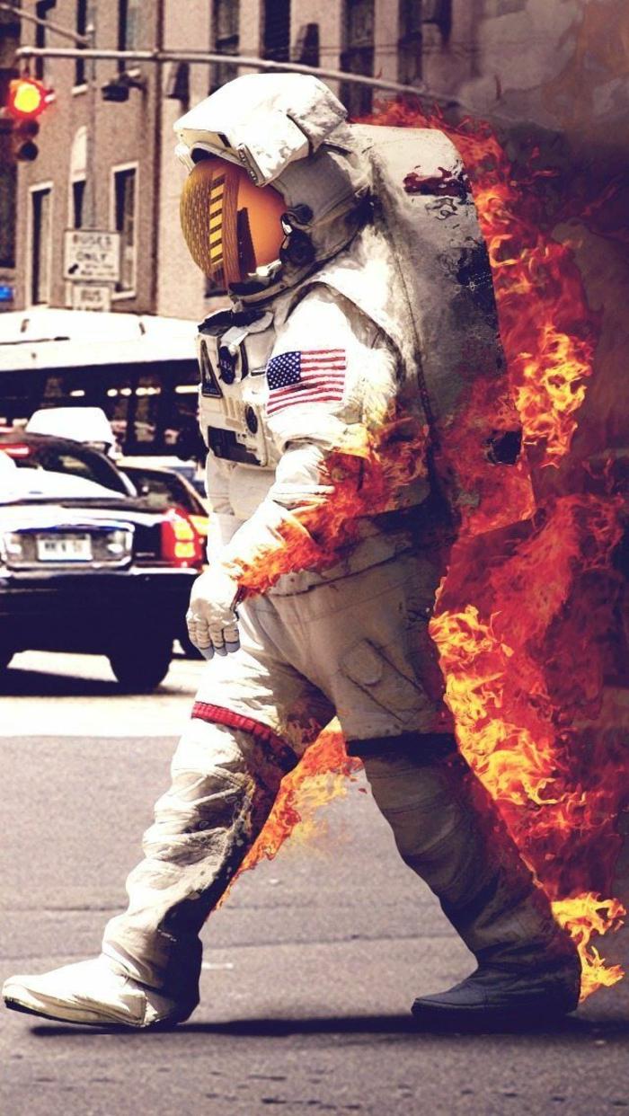 wallpaper handy, astronaut, kommt vom kosmos und brennt, weißer thermo kostüm, brennender mensch