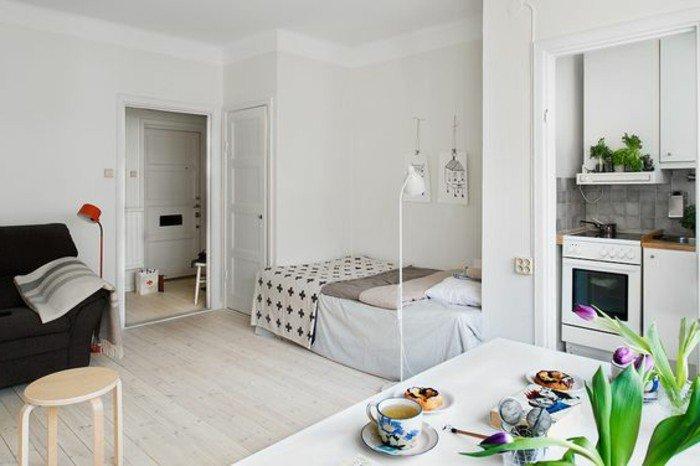 kleines schlafzimmer, mini küchenzeile, großer esstisch, bett skandinavischer stil