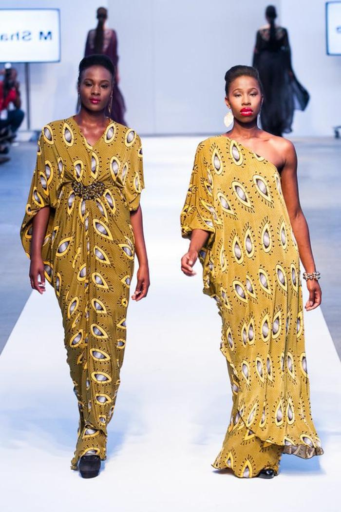 afrikanische kleidung ideen, zwei models in gelb grünem outfit, augen print dekoraitionen auf den kleidern