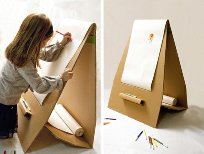 bett pappe, eine wand zum malen, kartondeko, kartonmöbel idee ein mädchen malt in seinem zimmer