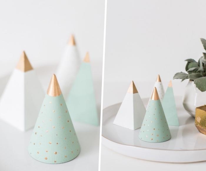 tannnebaum basteln, weiße servierplatte, kegel und pyramide aus holz, pfanze