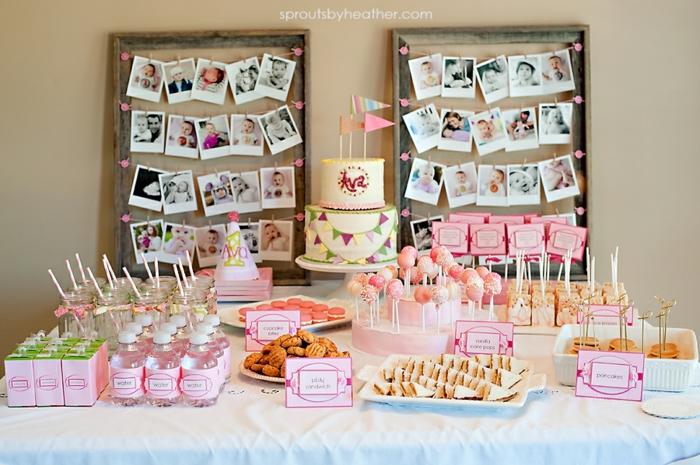 der erste Geburtstag ist von großer Bedeutung, viele Fotos von dem Baby, Tischdeko Geburtstag selber machen