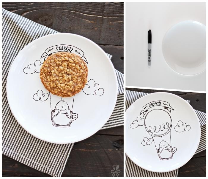 weißer teller bemalen, kekse mit nüssen, schwarzer marker, vogel zeichnen, heißluftballon