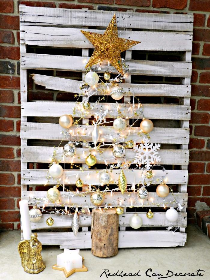 weihnachtsdeko basteln, weiße europalette, goldener stern, lichterkette, weiße weihanchtkugel