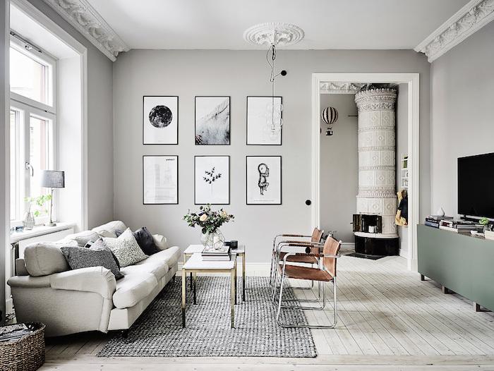 wandfarbe grau mit vielen symmetrischen wandbildern dekorierenm großes wohnzimmer