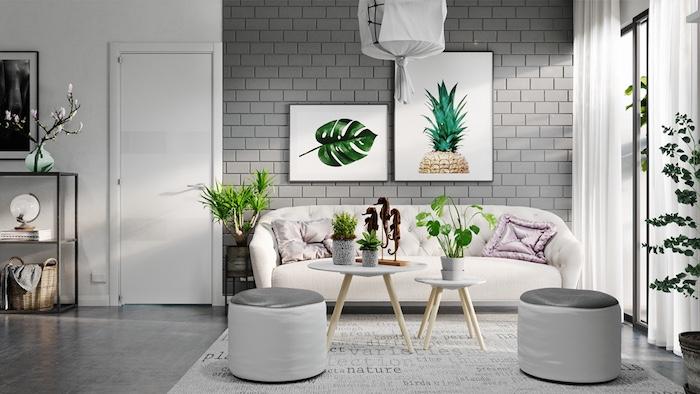wandfarbe grau, ziegel optik, ziegelwand grau, weiß und grün wandbilder, zwei hocker, großes weißes sofa