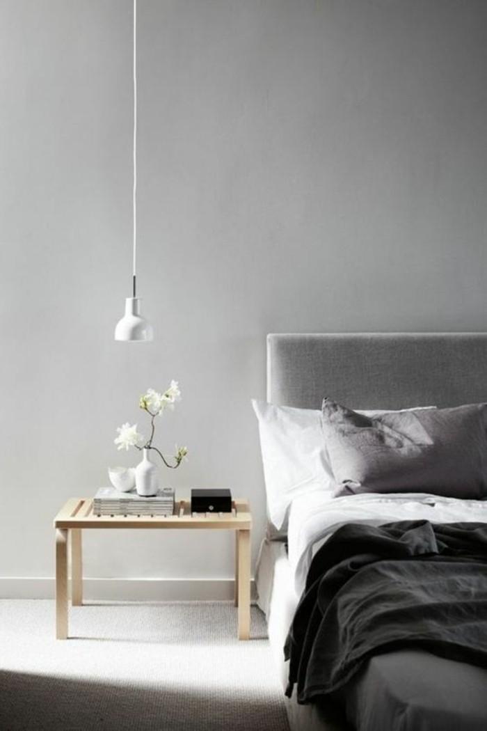 welche farben passen zusammen, klassische kombination schwarz und weiß, schlafzimmer design mit einer blume in vase neben dem bett