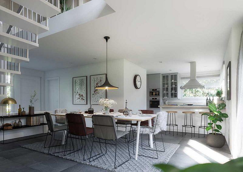 eine Küche mit weißen Wänden, eine Lampe und eine Wanduhr, ein grauer Teppich, Architekturpsychologie